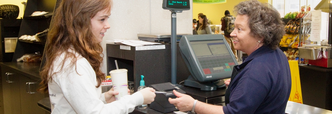 Student checking out at dining hall register