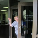 AppCard Office employee waving
